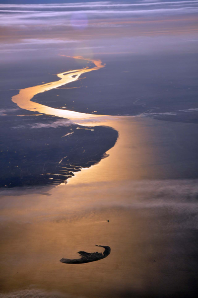 The mouth of the river Elbe, here in October 2010, marks the southeastern corner of the German Bight. The island is Trischen by Vincent van Zeijst